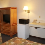 Balcony rooms have a microwave and refrigerator, wet bar sink area, and flat screen tv.