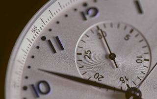Close up of watch dial with seconds hand.